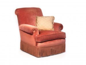 Ritz Paris Auction A strawberry velvet upholstered armchair and a light pink cushion