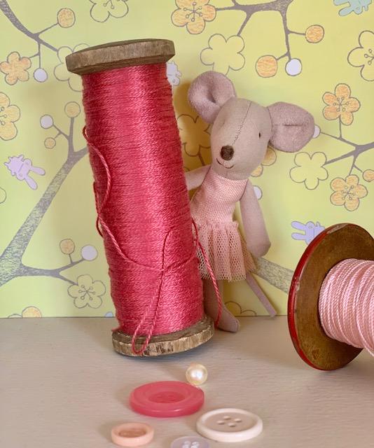 Maileg Ballerina behind a cotton reel in Maileg Tale